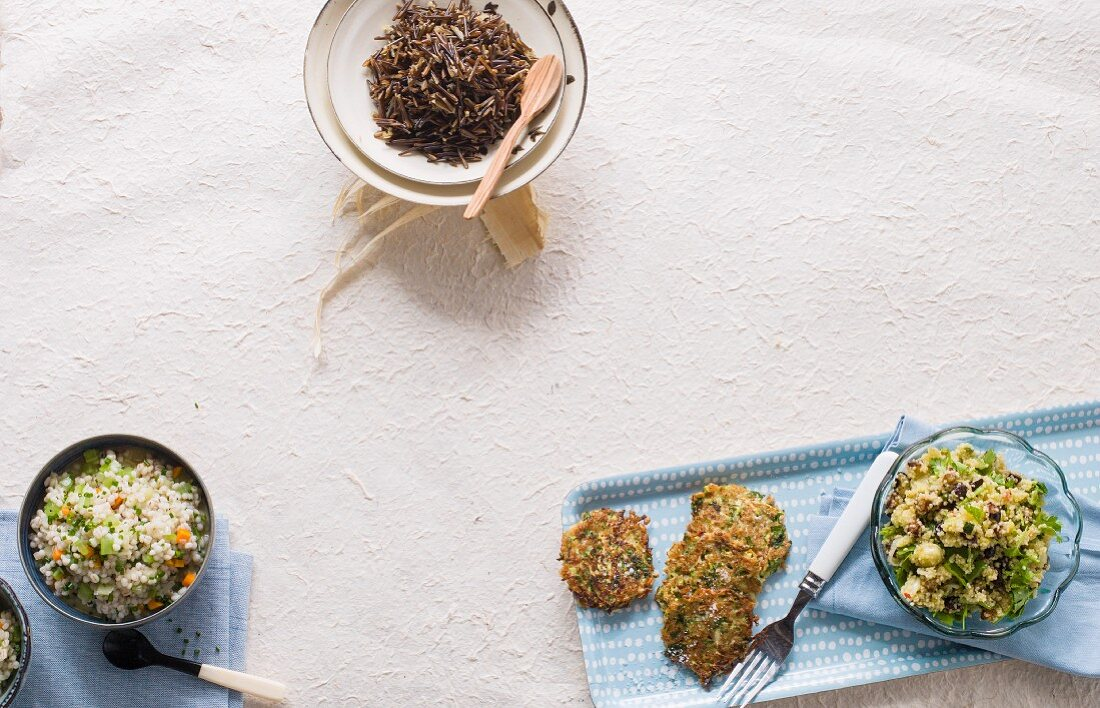 Barley risotto, wild rice, unripe spelt grain cakes and a couscous salad