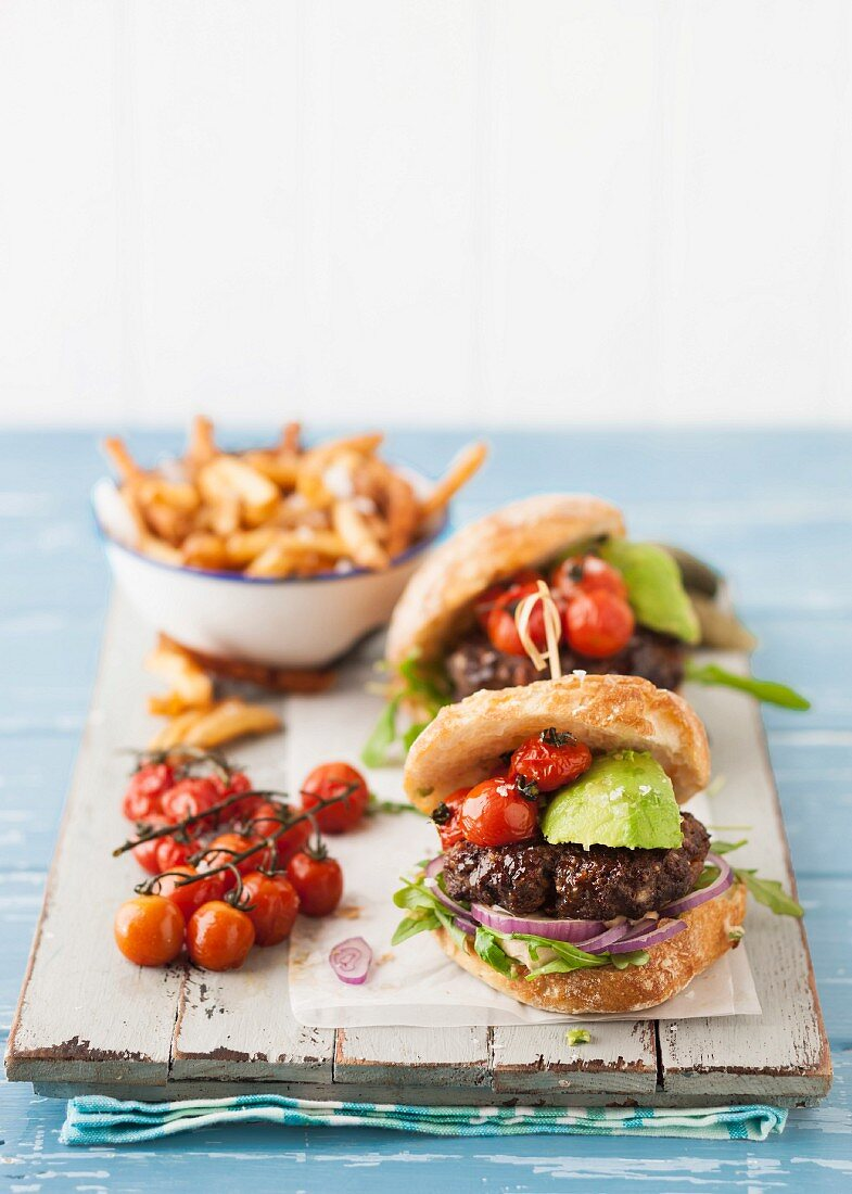 Burgers with avocado and tomatoes