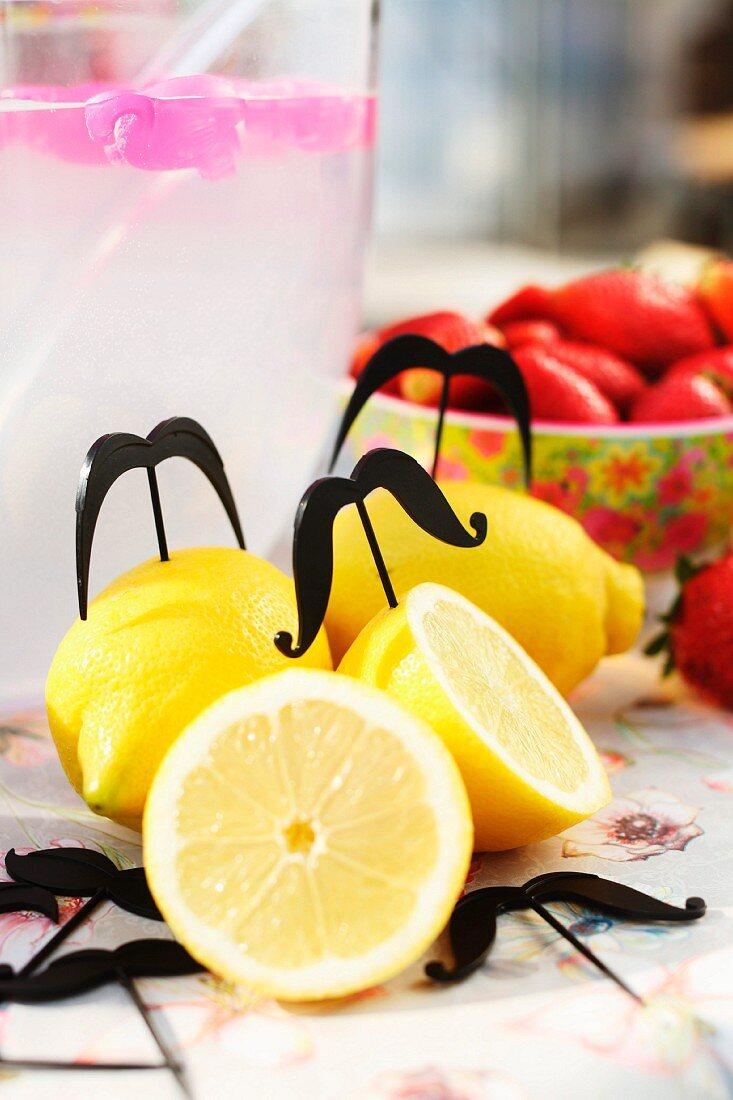 Metal skewers in lemons on party table