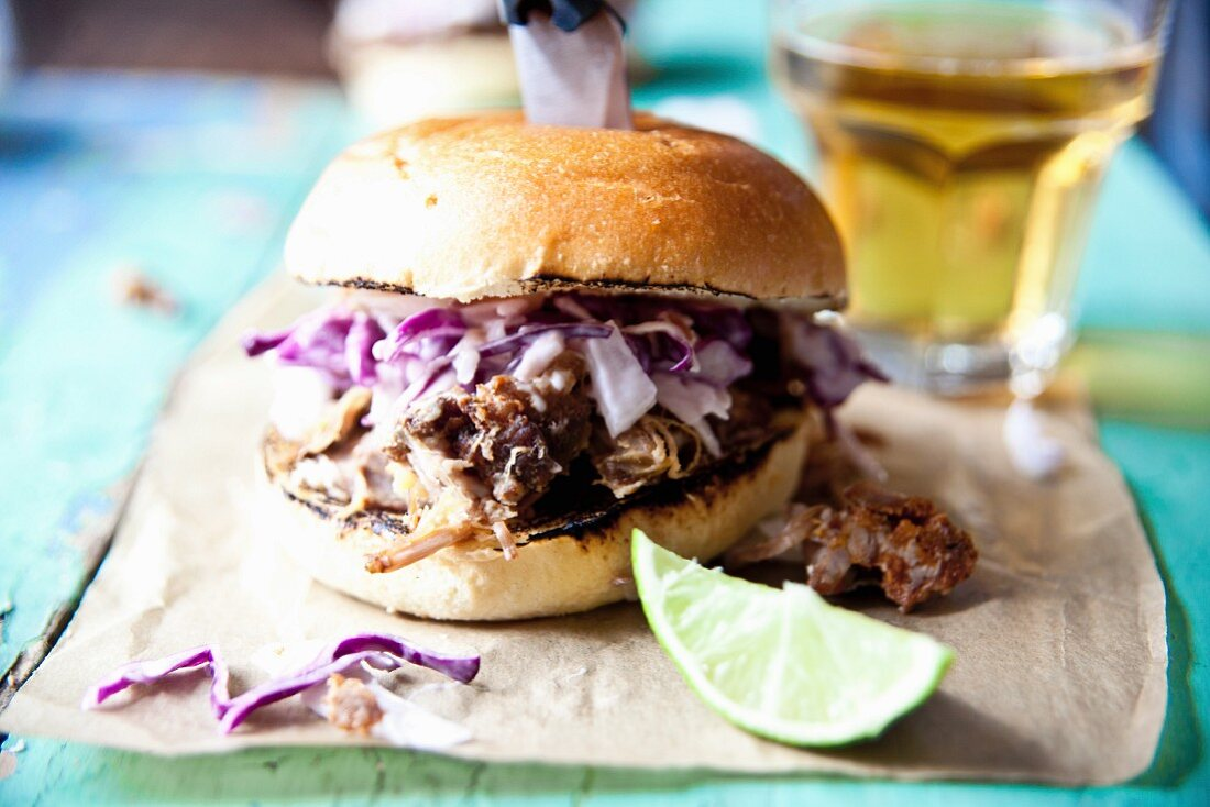 A pulled pork slider with red cabbage and apple