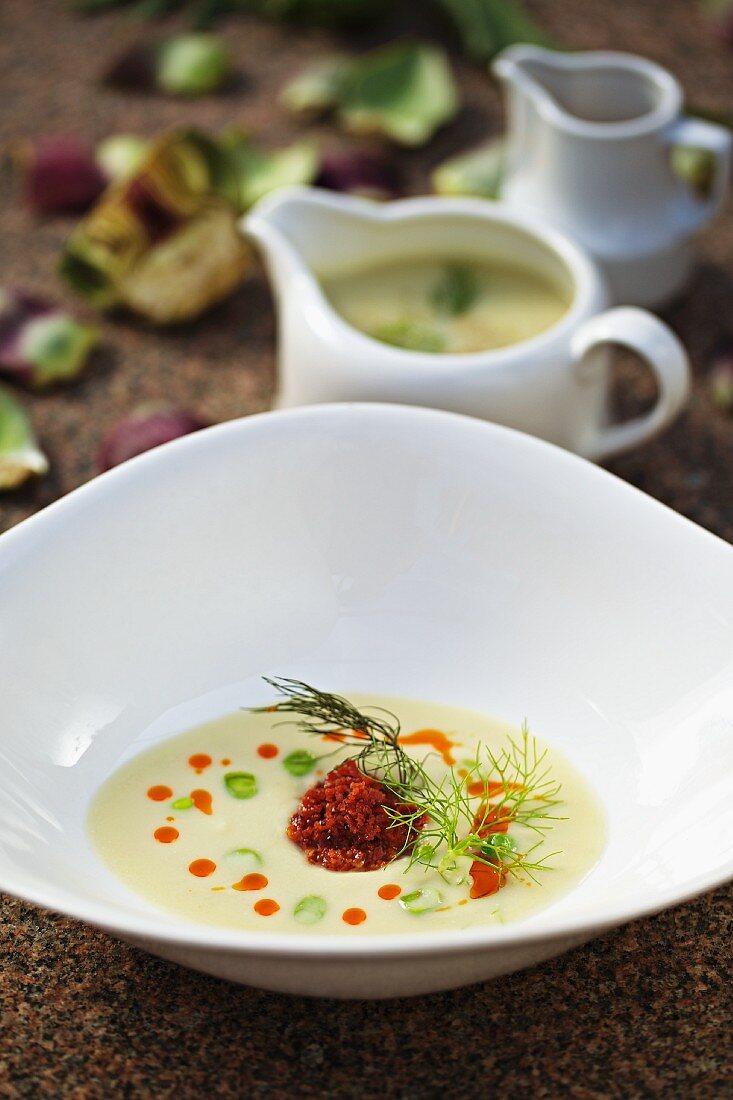 Cream of artichoke soup with chorizo and peas