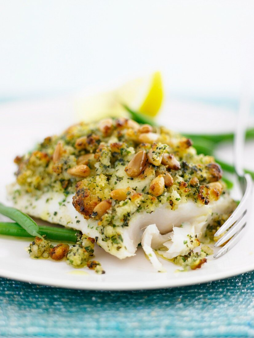 Hake fillet with a herb crust and pine nuts