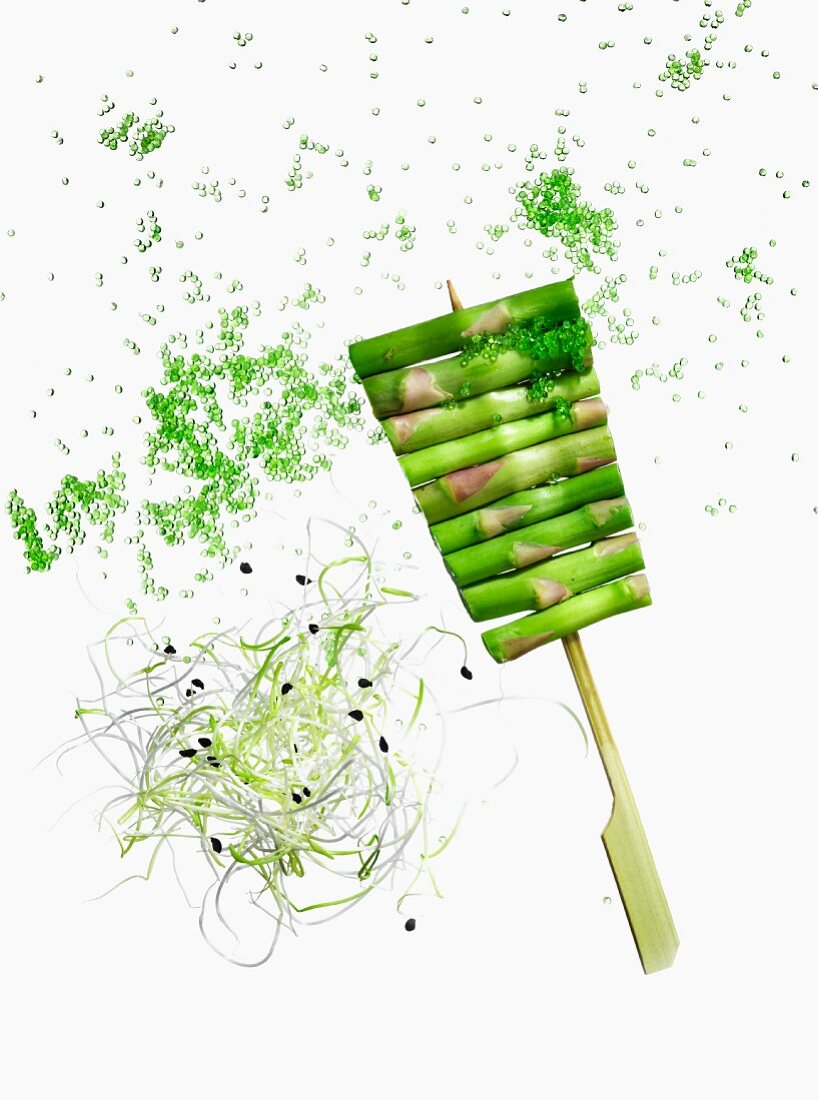 Green asparagus skewer with radish shoots