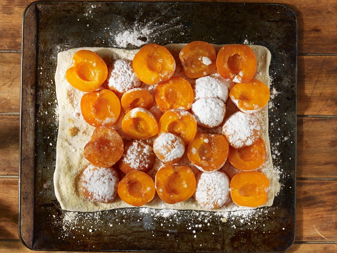Oven-ready apricot and almond tart dusted with icing sugar
