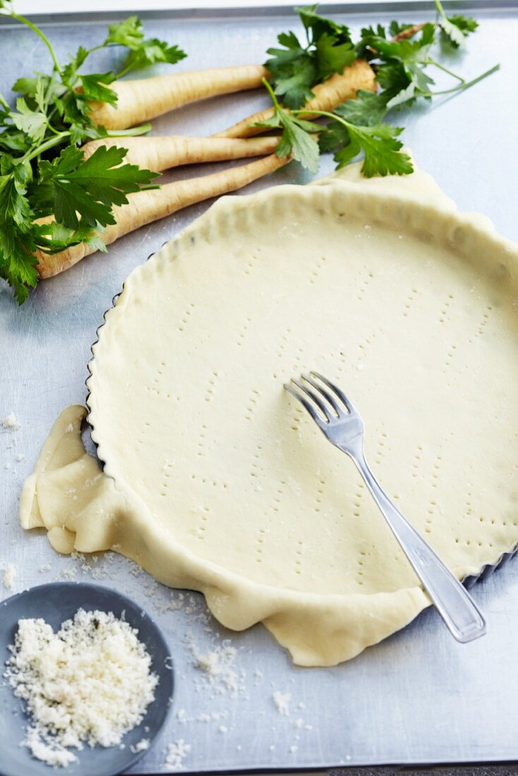 Shortcrust pastry in a quiche tin