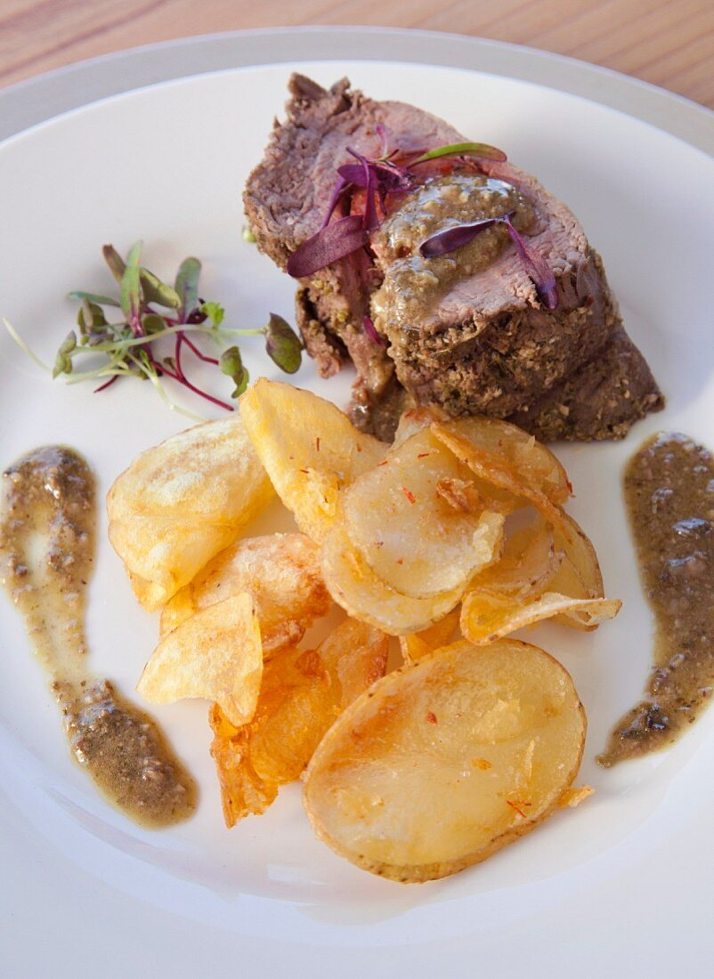 Beef fillet with chorizo with a herb crust served with homemade potato crisps