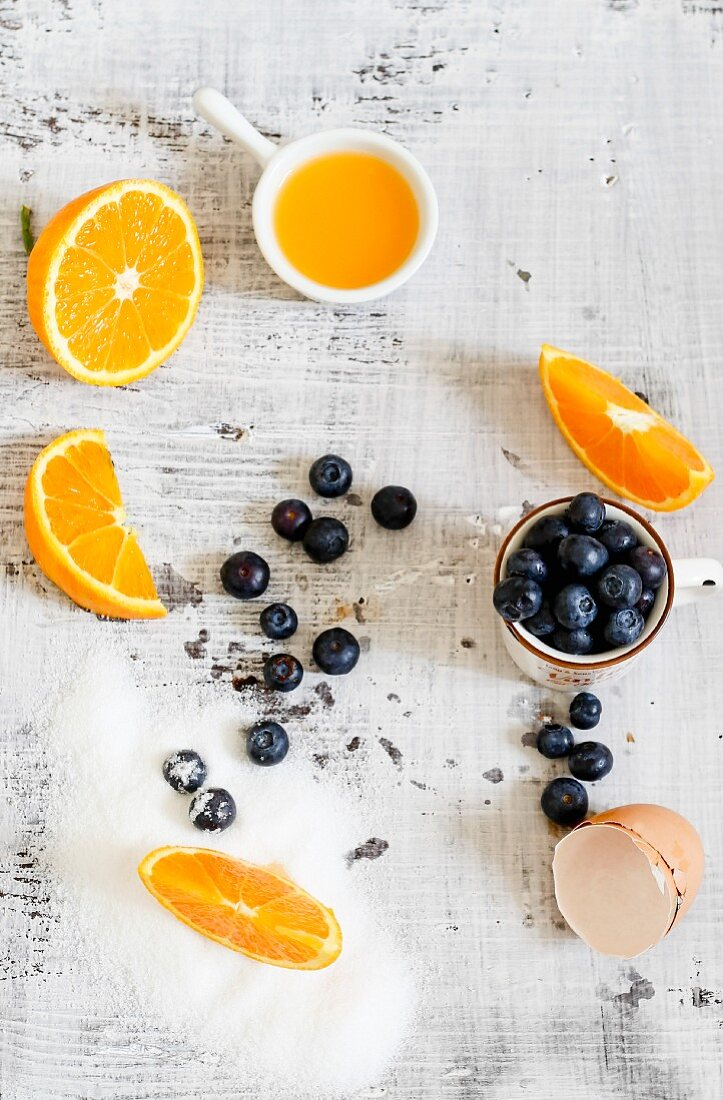 An arrangement of oranges, blueberries and egg shells
