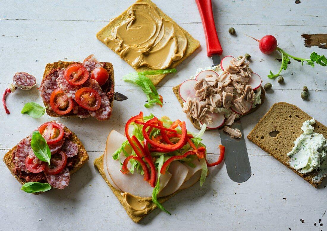 ADHD food: pizza rolls, turkey sandwich and a tuna fish open sandwich