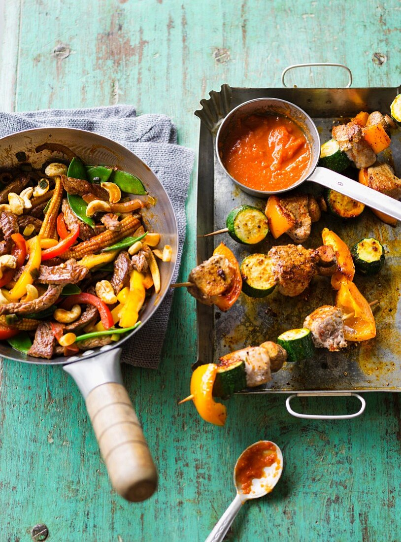 Beef stir fry and meat and vegetable skewers
