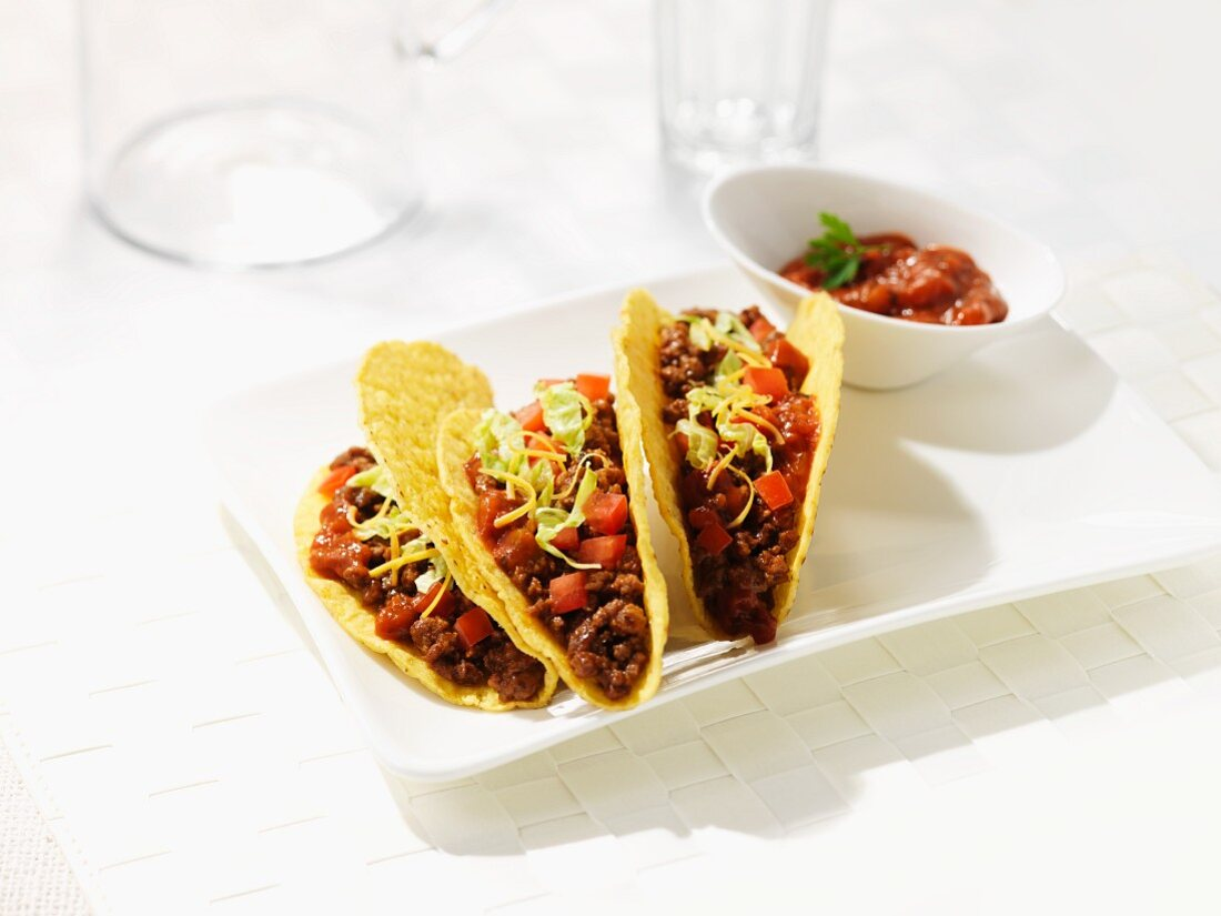 Corn tortillas filled with beef and bean salsa