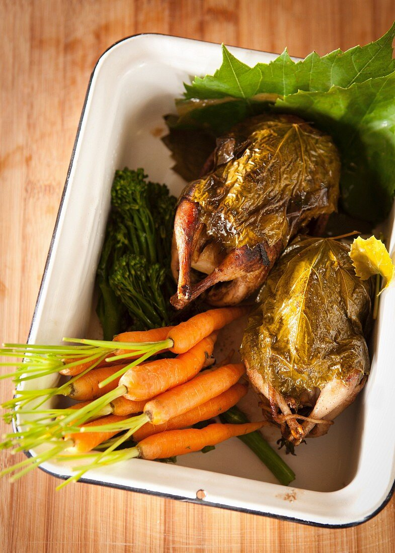 Quails wrapped in vine leaves