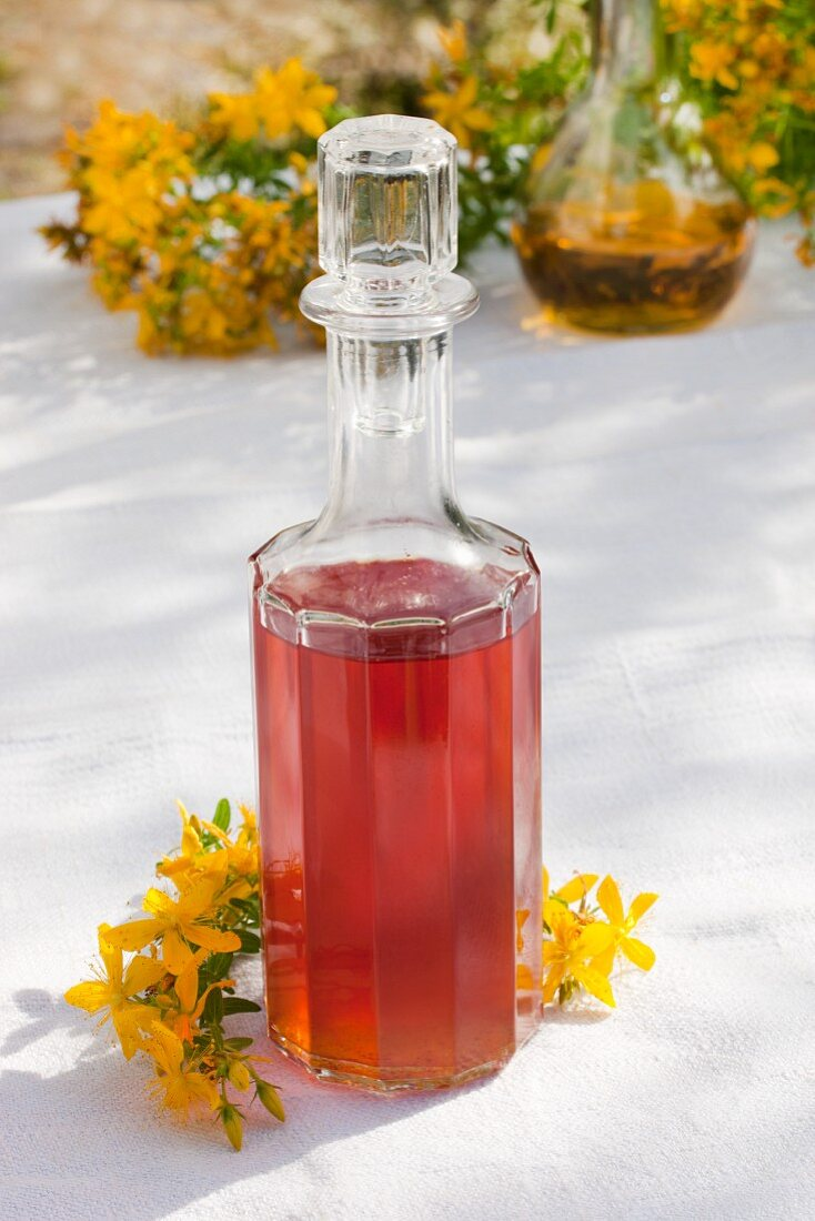 A glass bottle of home-made red oil (St John's Wort flowers in olive oil)