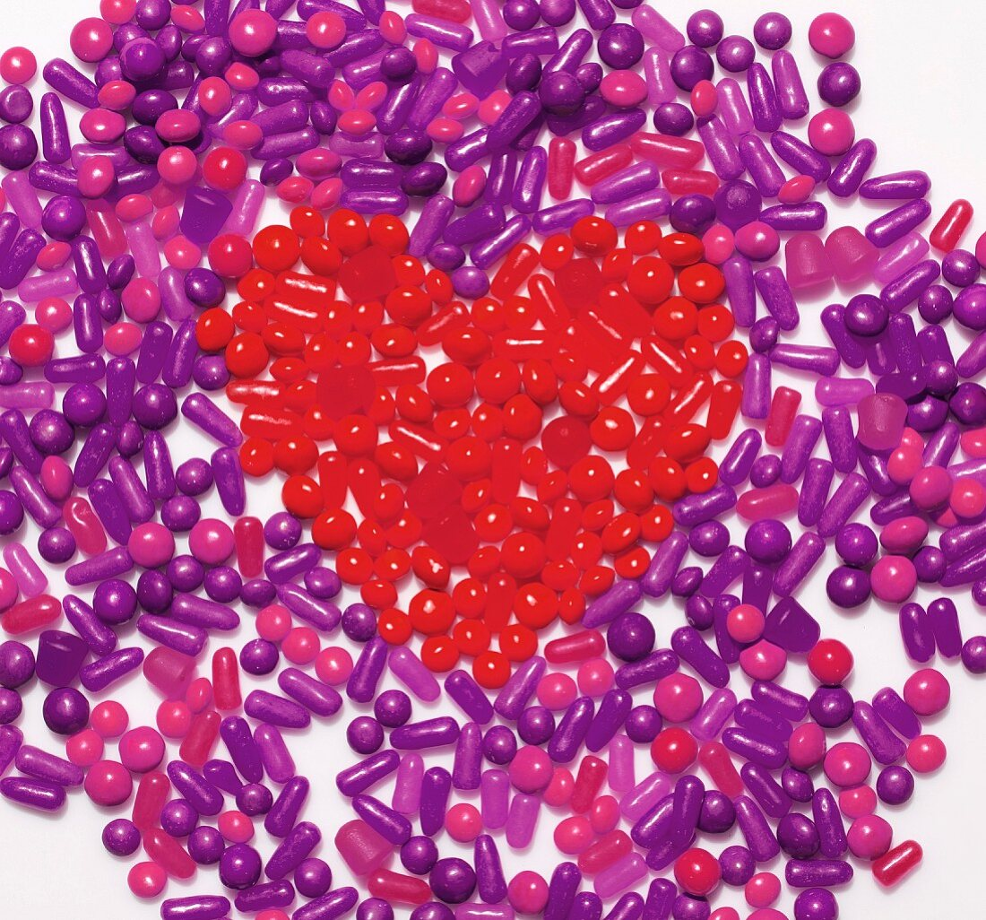 Purple sweets with a heart made from red sweets in the middle