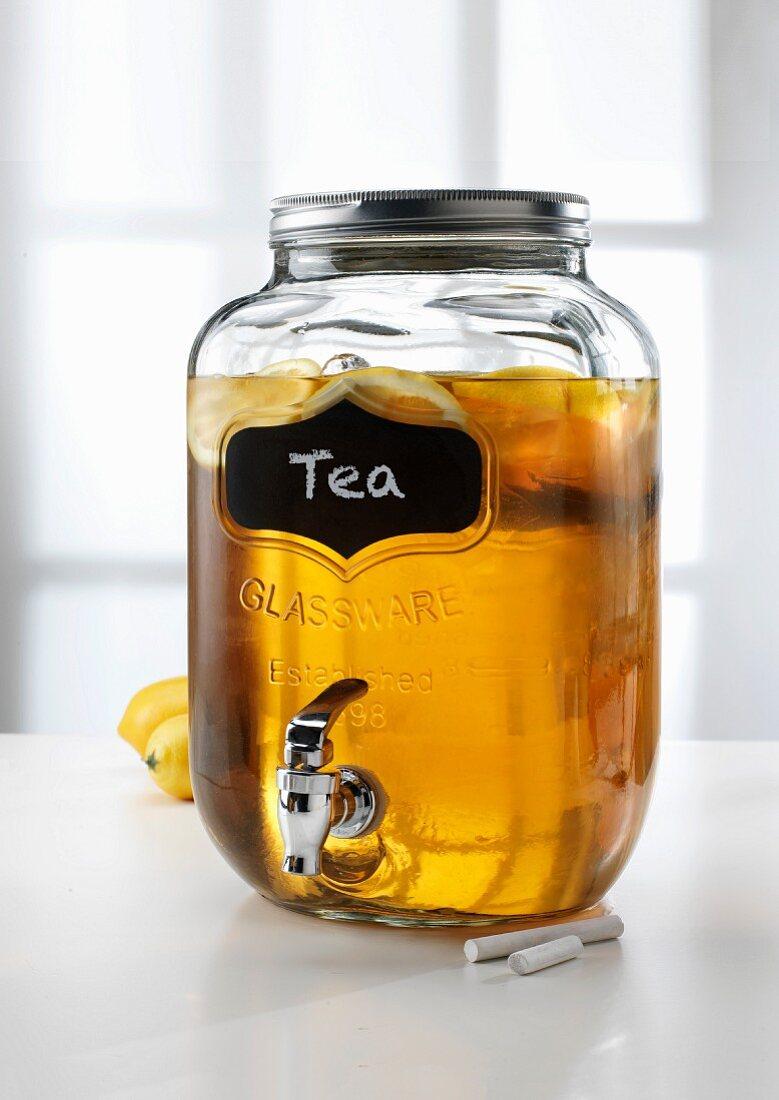 Lemon tea in a jar with a tap