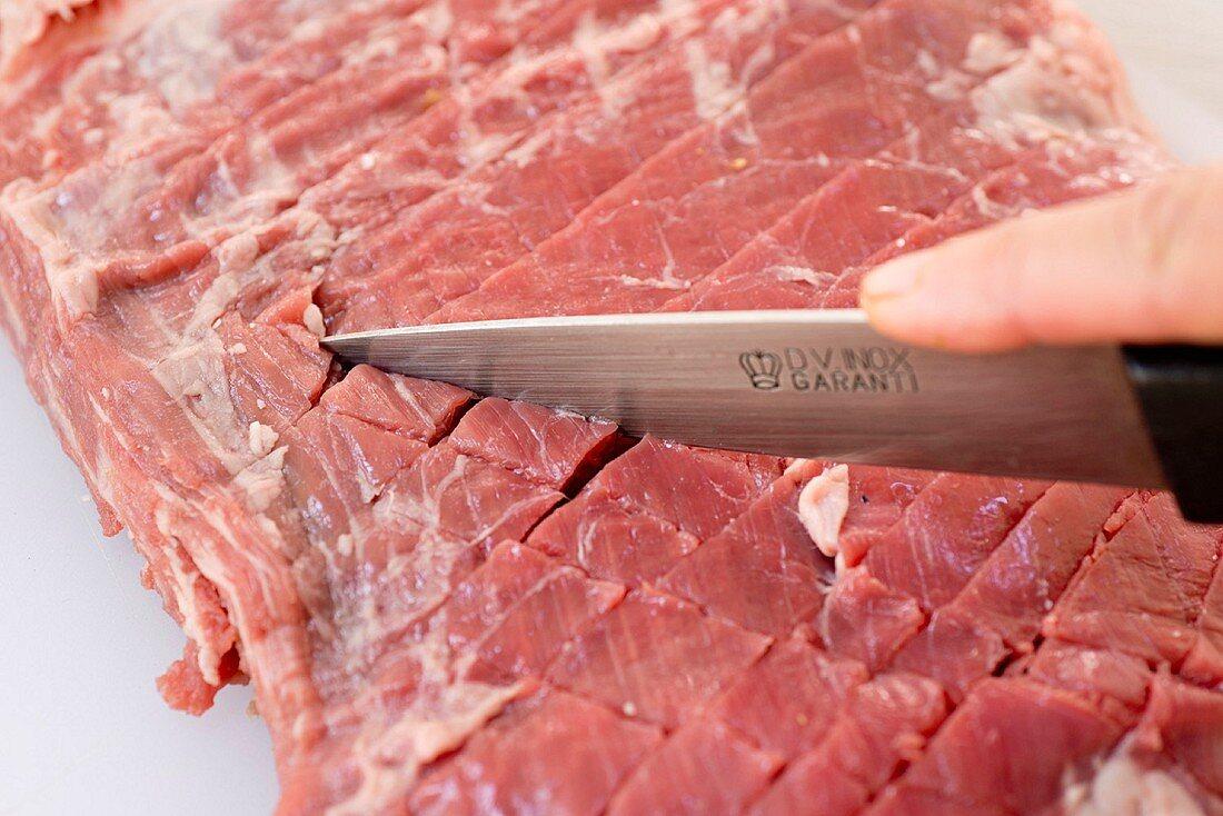 A steak being scored