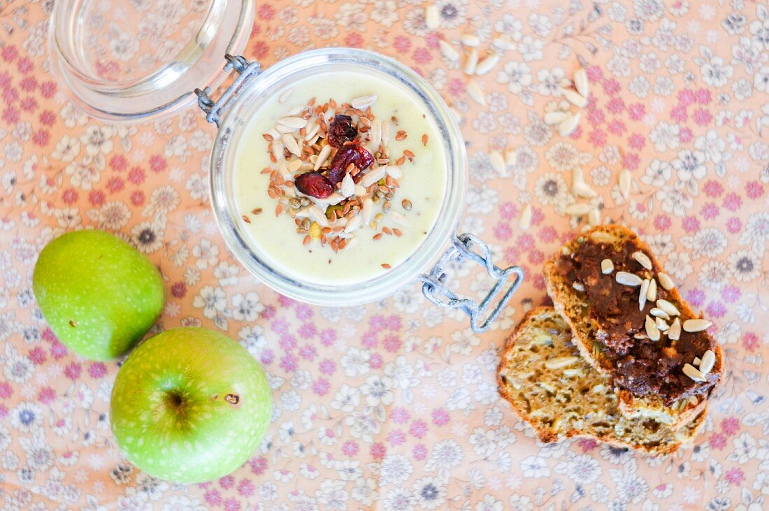 A green apple smoothie and rye bread with chocolate spread
