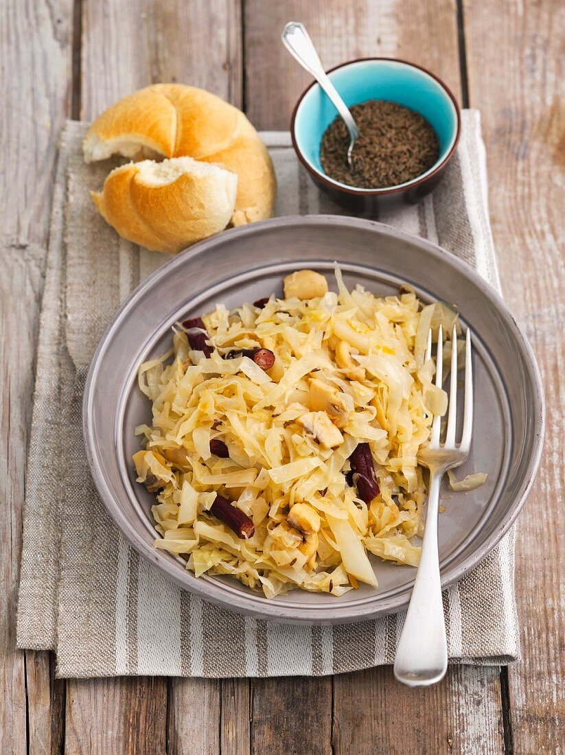 Braised white cabbage with mushrooms and sausage