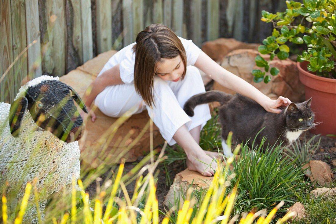 Girl and cat in garden
