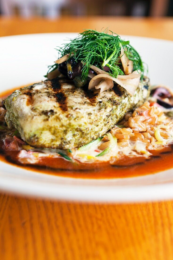 Grilled swordfish on a bed of kamut risotto with fennel and kalamata relish