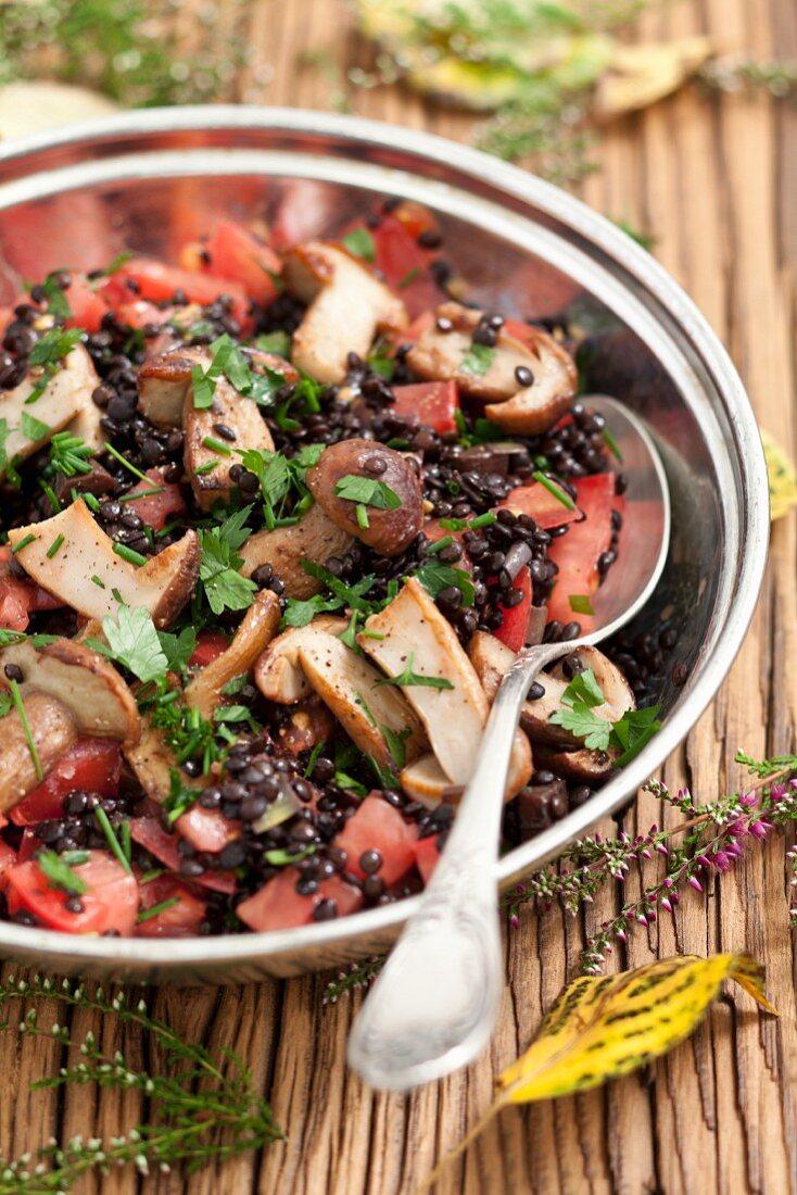 Porcini mushroom salad with beluga lentils and tomatoes