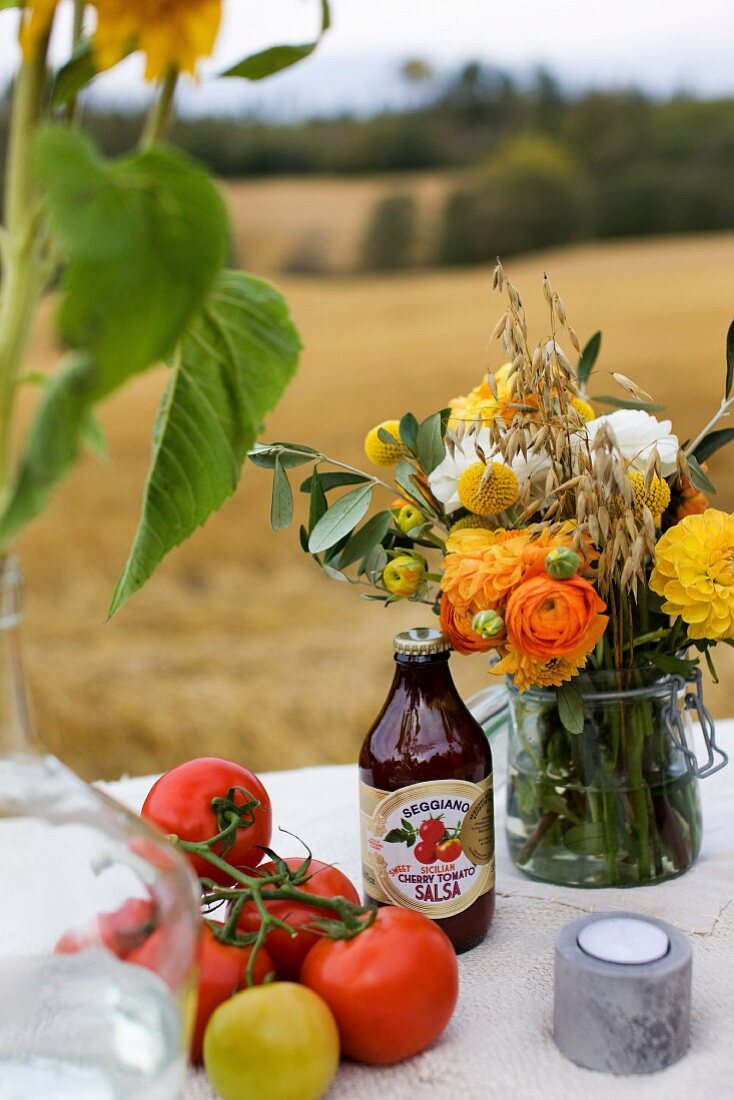 A bunch of flowers, tomatoes and tomato sauce