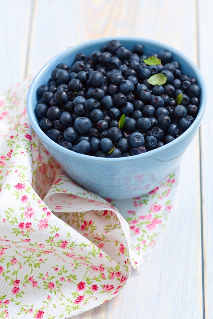 Blueberries in a light-blue bowl