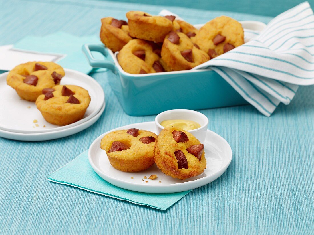 Mini corn muffins with sausages and mustard