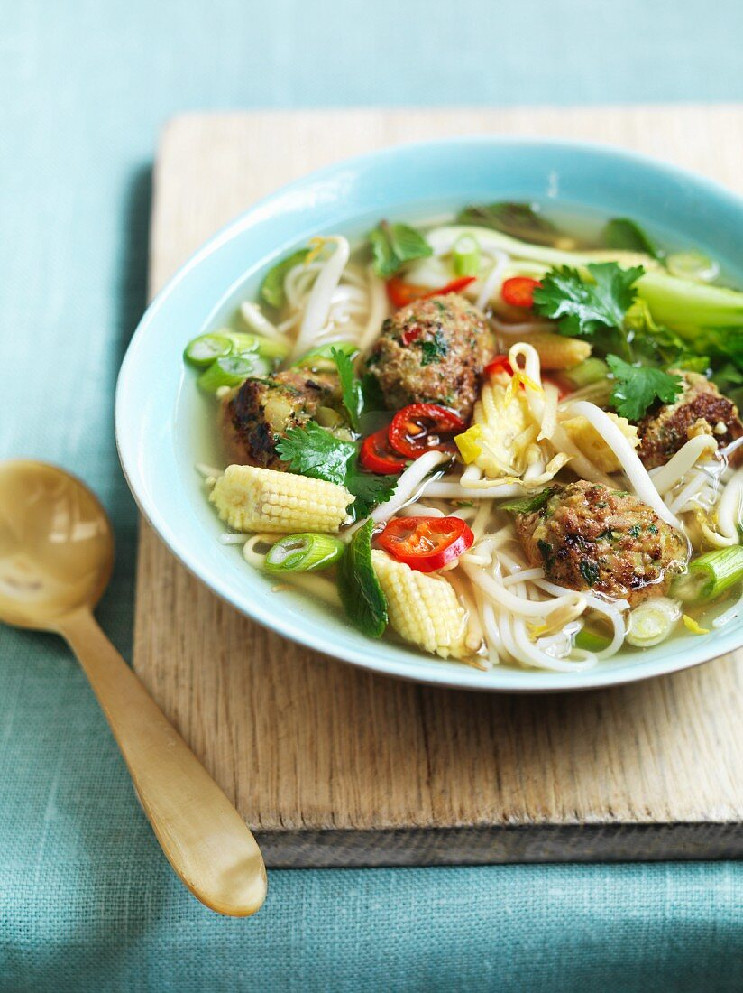 Noodle soup with turkey dumplings and corn cobs (Asia)