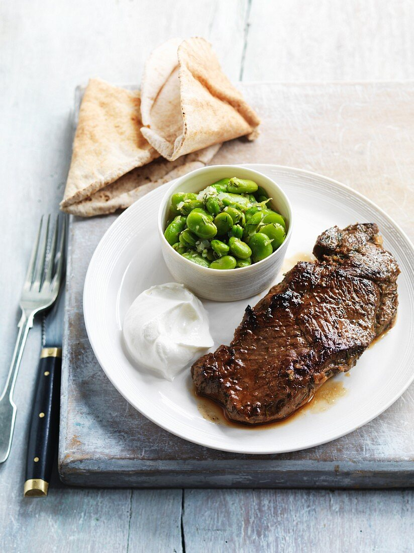 Marinated lamb steak with yoghurt and broad beans