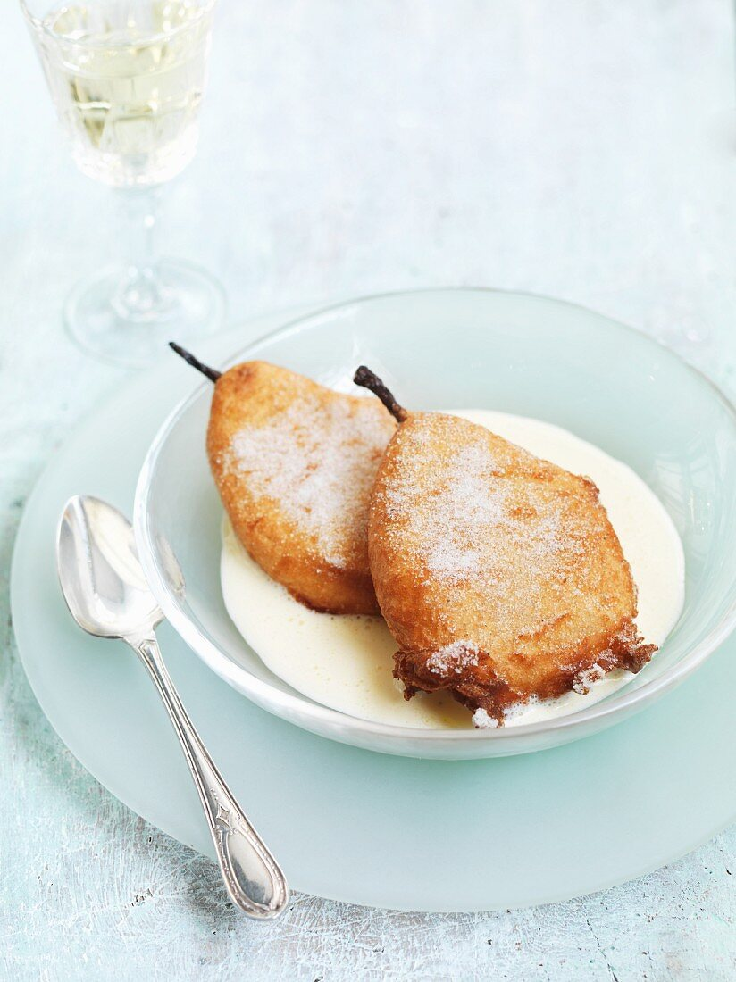 Pear beignets with rosemary sugar and vanilla sauce