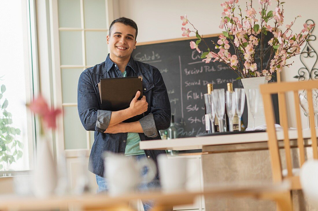 A smiling waiter in a cafe