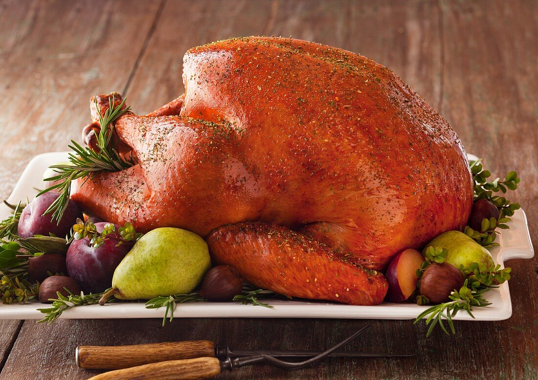 Roast turkey with fruits and herbs