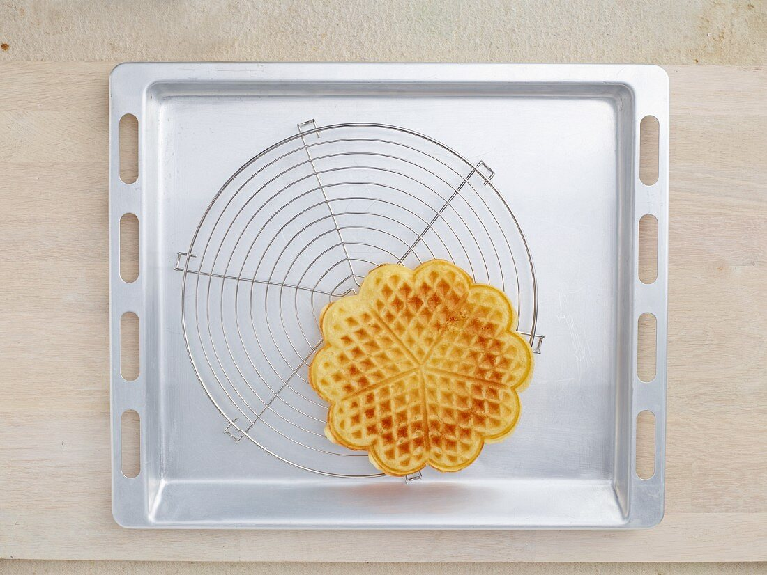 A hot waffle on a wire rack
