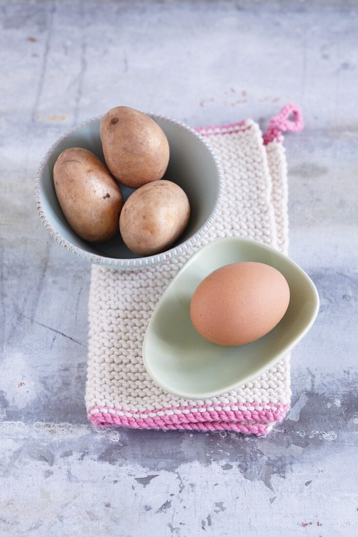 Potatoes and eggs, unpeeled