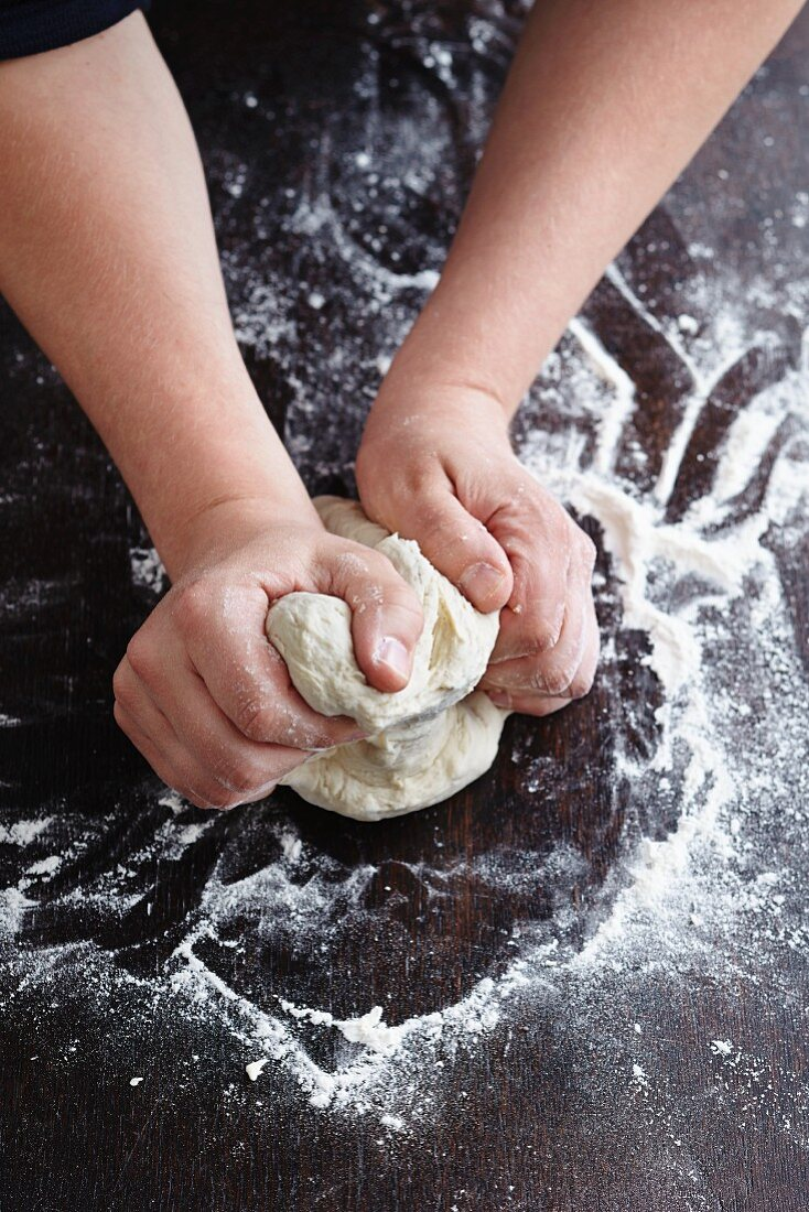 Lahmacun being made: yeast dough being kneaded on a floured work surface