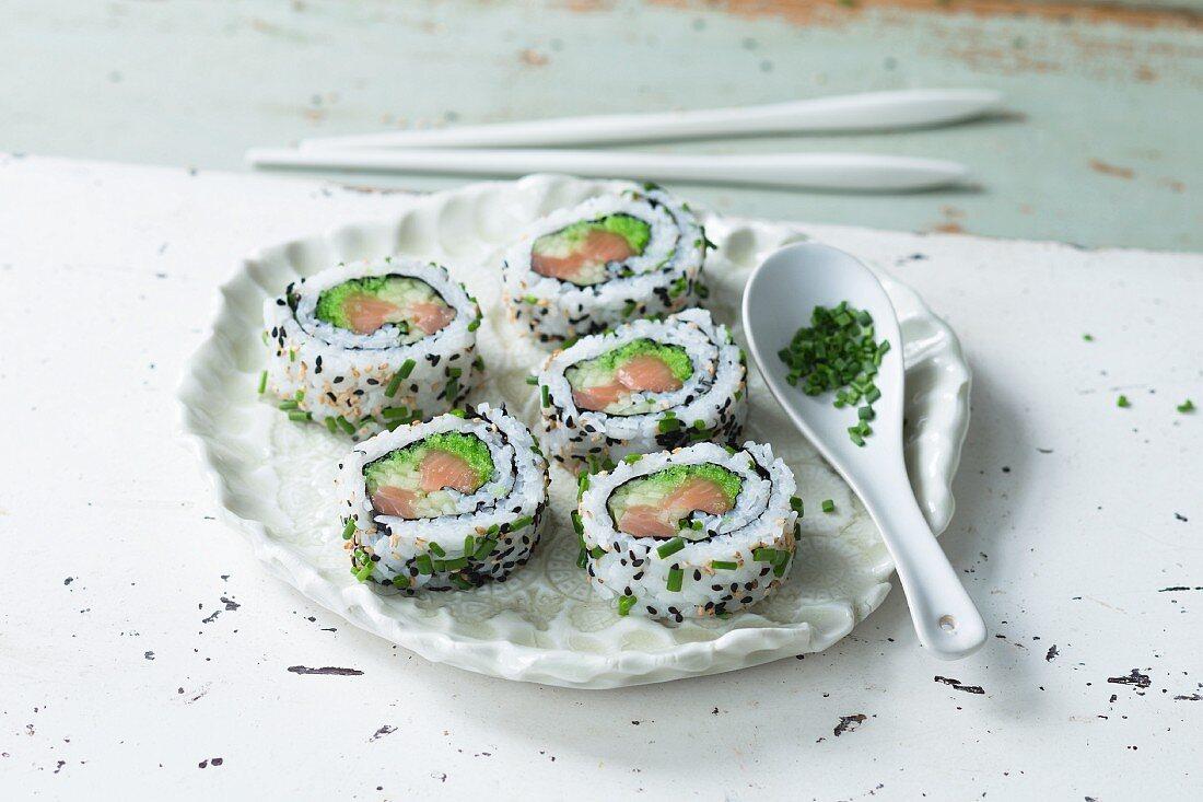 Uramaki sushi with green fish roe and fish