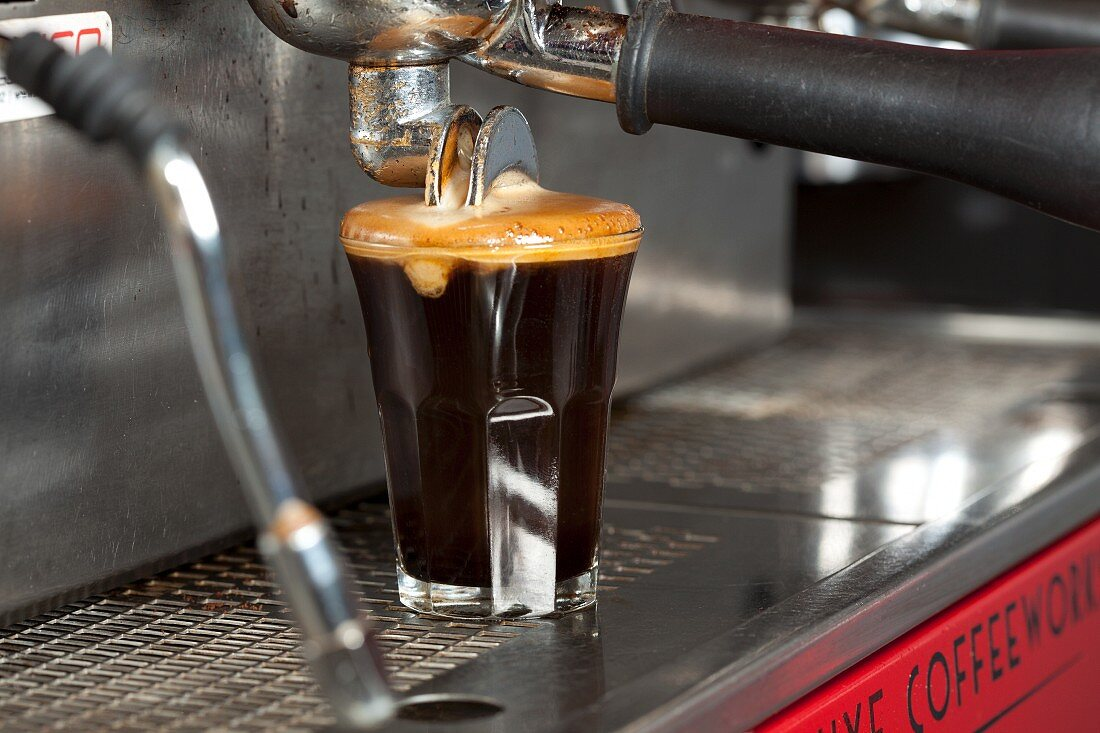 Espresso Pouring From Machine into Two Glasses