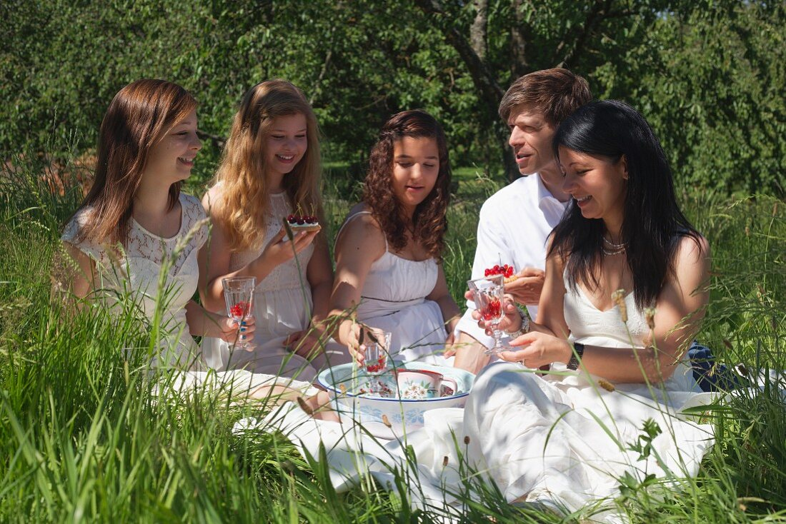 A family having a cherry picnic