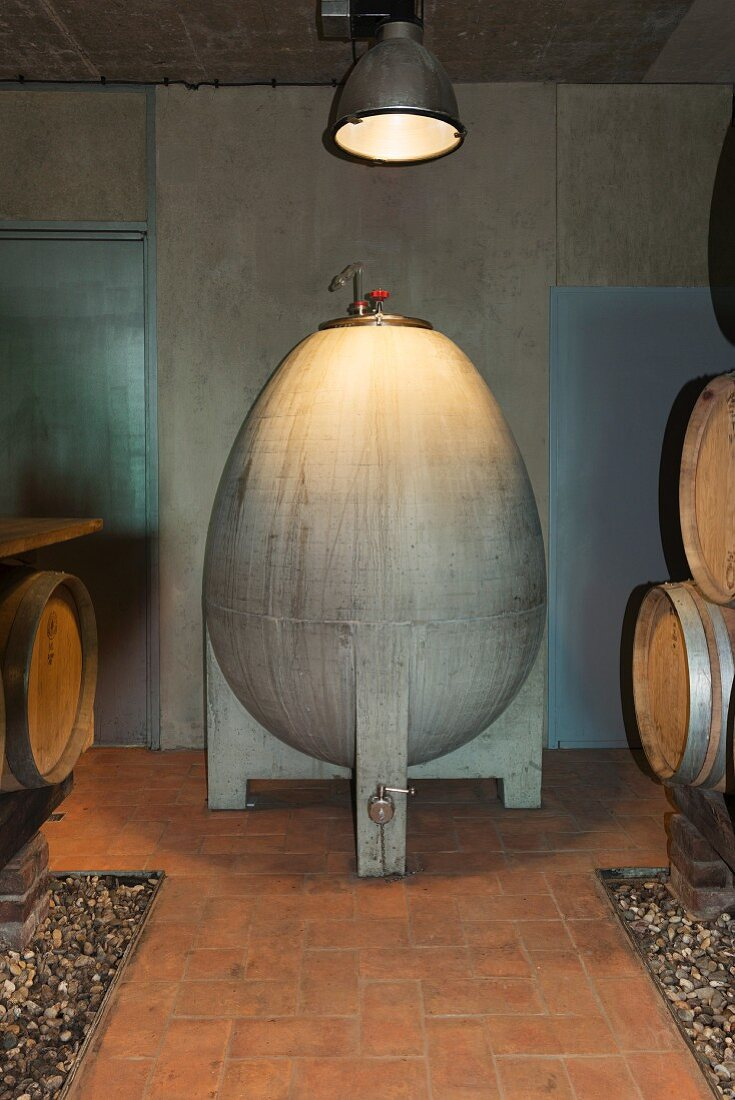 An egg shaped concrete container in a wine cellar at Weingut am Stein, Würzburg