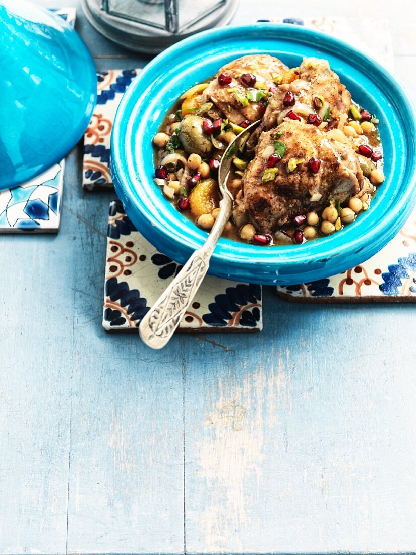 Chicken tagine with a fruity sauce, chickpeas and pomegranate seeds