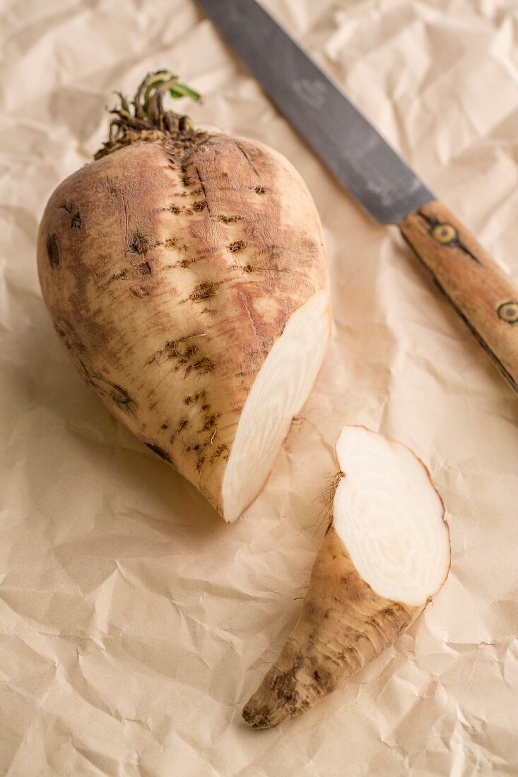 A sliced sugar beet on a piece of paper