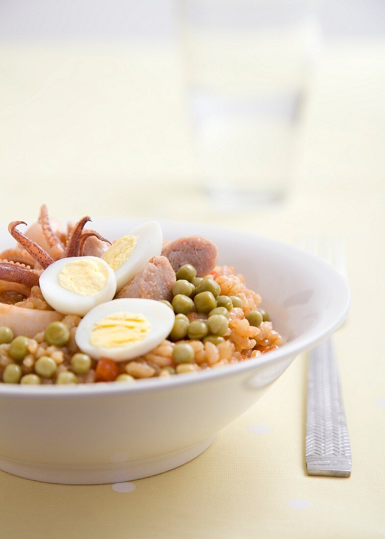 Rice with squid, sausage and hard-boiled egg