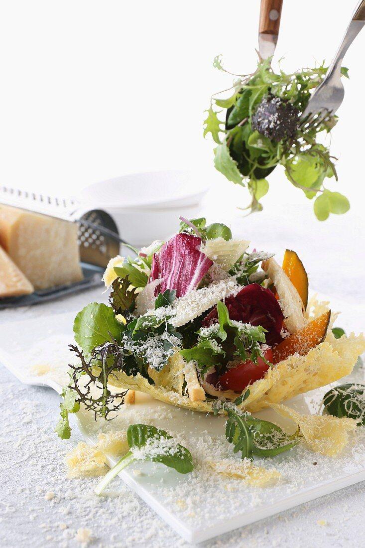 A mixed leaf salad served in a Parmesan basket
