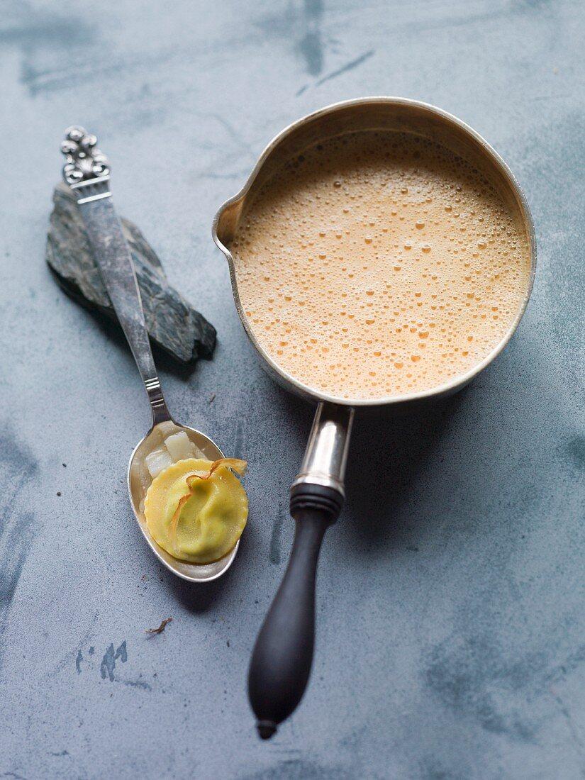 Crayfish soup with artichoke ravioli