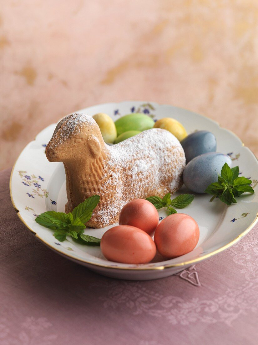 An Easter lamb with colourful eggs