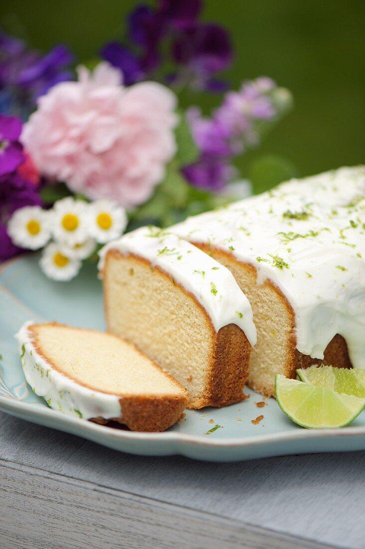 Caipirinha cake with a yoghurt glaze and lime zest