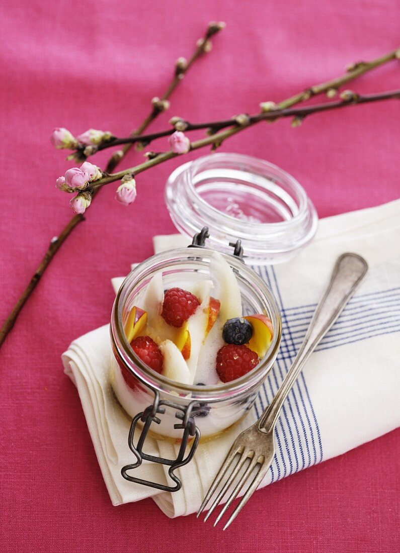 Melon soup with fruit pieces and berries