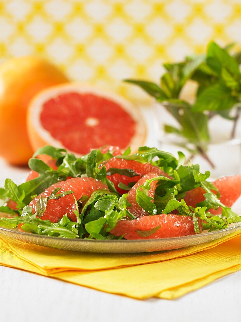Rocket and grapefruit salad on a glass plate