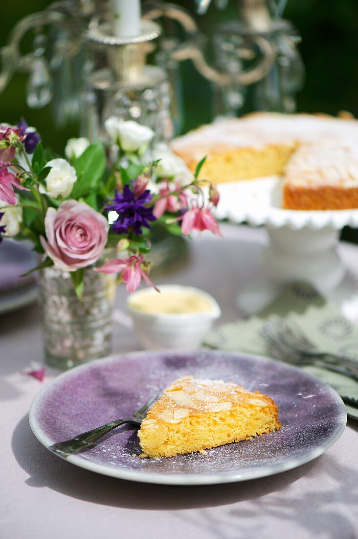 A slice of almond cake and crème anglaise with honey mustard