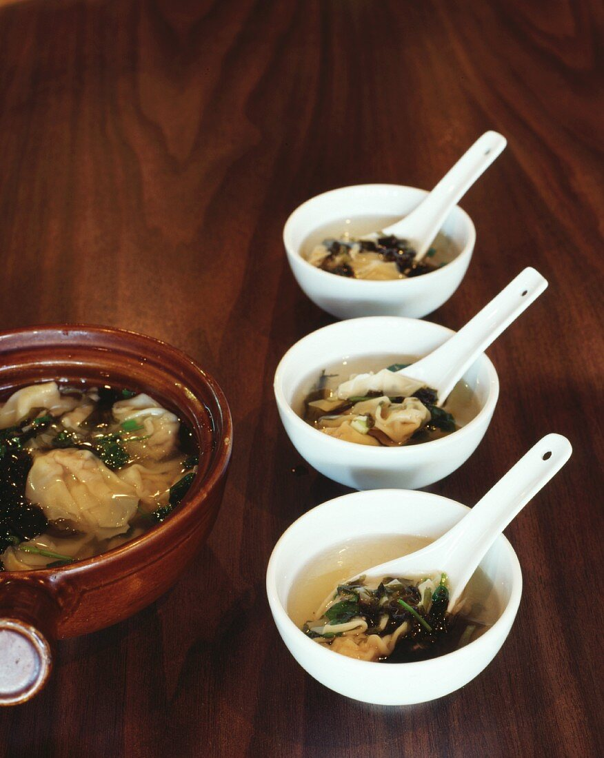 Steamed wontons filled with pork in a clear broth